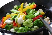 stock photo of ladle  - stir fried vegetables in a chinese wok - JPG