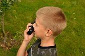 The Boy Is Talking On The Walkie-talkie. Boyish War Games. poster
