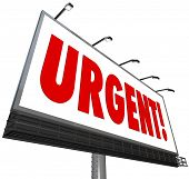 The word Urgent in big red letters on a white outdoor billboard sign to grab attention for an import
