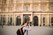 Stockholm, Sweden. Young Adult Caucasian Woman Lady Tourist Traveler Photographer Taking Pictures Ph poster