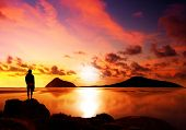 stock photo of person silhouette  - Silhouette of man reflecting while looking at a gorgeous sunset - JPG