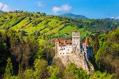 Popular Transylvanian Touristic Location With Famous Picturesque Bran Castle And Spring Rural Landsc poster