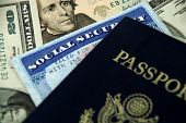 stock photo of social-security  - social security card a passport and several dollar notes - JPG