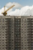 Apartment Building Under Construction. High-rise Apartment Building Under Construction And Crane Aga poster