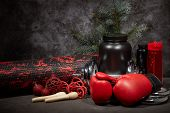 Sports nutrition (supplements), sports equipment, branch of fir,  Christmas ornaments on dark grey b poster