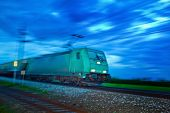 foto of noise pollution  - a freight train travels through the night - JPG