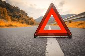 Autumn Road Red Triangle, Red Emergency Stop Sign, Red Emergency Symbol On Road. With Copy Space For poster