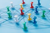 Small Network Of Pins (thumbtack)and String, An Arrangement Of Colorful Pins Linked Together With St poster