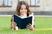 Who Needs Rest When Theres Another Book To Be Read. Adorable Small Child Read Book On Green Grass. C poster