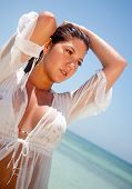 foto of wet t-shirt  - Sexy woman at the beach with a wet t - JPG