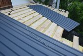 Roofing Construction. Installing  Lightweight Metal Roof Tiles Roofing  Construction On House Roofin poster