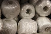 Many Skeins Of White Rope, Background. Many Tubers Of White Economic Twine. poster