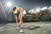 image of snickers  - portrait of young beautiful woman playing tennis in summer environment - JPG