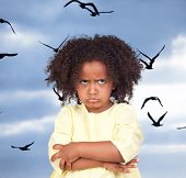 stock photo of angry bird  - Angry little girl with beautiful hairstyle and many birds flying - JPG