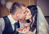 picture of pie-in-face  - happy bride and groom kissing - JPG
