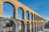 stock photo of aqueduct  - Ancient roman aqueduct of Segovia at Castile and Leon Spain - JPG