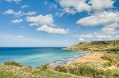 stock photo of gozo  - Ramla Bay located on the northern side of the Maltese island of Gozo - JPG