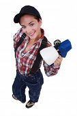 stock photo of spayed  - Woman with paint spaying device - JPG