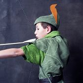 foto of fletching  - Young Robin Hood drawing a bow and arrow - JPG