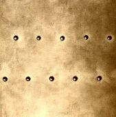 stock photo of stelles  - Gold grunge metal plate or armour texture with rivets as background square format - JPG
