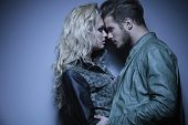 image of hunk  - young embraced fashion couple standing face to face - JPG