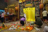 AMPANG - OCTOBER 9: Devotees of the Buddhism-Taosim faith give offerings and pray at the Kau Ong Yah