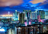 foto of overpopulation  - Downtown cityscape in Hong Kong at night - JPG