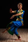 stock photo of bharata-natyam  - Young beautiful woman dancer exponent of Indian classical dance Bharatanatyam in Shiva pose - JPG