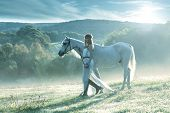 stock photo of horse-riders  - Beautiful sensual women with white horse  - JPG