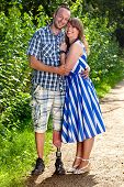 picture of amputee  - Confident attractive smiling young couple in a loving embrace standing outdoors on a gravel path  - JPG