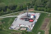stock photo of rig  - Aerial view of Marcellus shale natural gas drilling rig in Southwestern Pennsylvania - JPG