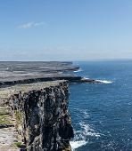 stock photo of galway  - Dun Aonghasa or Dun Aengus is the most famous of several prehistoric forts on the Aran Islands of County Galway Ireland - JPG