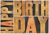 happy birthday - isolated text abstract - letterpress wood type printing blocks scaled to a rectangl