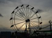 picture of ferris-wheel  - Ferris wheel at sunset along the beach in North Carolina - JPG