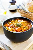 pic of chickpea  - Vegetables soup with chickpea by bread loaf - JPG