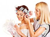 stock photo of hair curlers  - Woman with hair curlers on head wear in wedding dress  - JPG