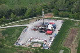 stock photo of shale  - Aerial view of Marcellus shale natural gas drilling rig in Southwestern Pennsylvania - JPG