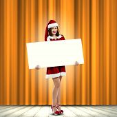 Girl in Santa costume with white blank banner. Place for text