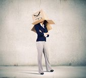 Businesswoman in suit wearing carton box on head