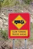 Slow Turning Trucks Ahead Sign 1