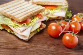 stock photo of nic  - Sandwiches with chicken breast salad cheese and tomatoes on wooden table - JPG