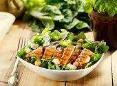 picture of caesar salad  - bowl of chicken salad on wooden table - JPG