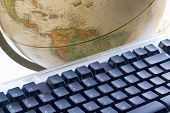 stock photo of midterm  - Computer keyboard and earth globe - JPG
