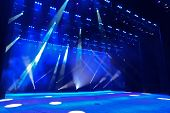 foto of smoke  - Illuminated empty concert stage with smoke and rays of light - JPG