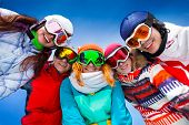 stock photo of mating  - Happy smiling friends of 4 women and 1 man posing in half circle with ski mask - JPG