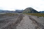stock photo of bromo  - Wide dirty road to Botok and Bromo volcanoes Indonesia - JPG