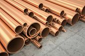 foto of warehouse  - An image of some nice copper pipes in a warehouse - JPG