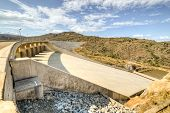 image of dam  - The Maguga Dam is a dam on the Komati River in Hhohho Swaziland. It is 115 metres high and is located 11 kilometres south of Piggs Peak.