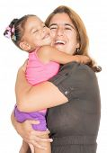 Mother giving a strong hug to her small multiracial daughter and laughing isolated on white