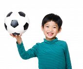 Young boy holding soccer ball
